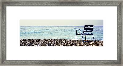 Vacant Chair On The Beach, Nice, Cote Framed Print by Panoramic Images