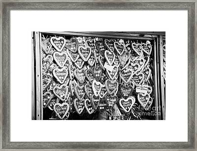 various Lebkuchen hearts hang for sale from a stall in the christmas market Berlin Germany Framed Print