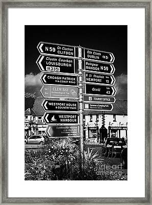 Various Road Direction Signs In Westport County Mayo Republic Of Ireland Framed Print by Joe Fox