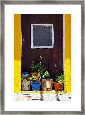 Vases On The Doorway Framed Print by Carlos Caetano