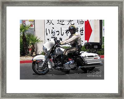 Vegas Motorcycle Cop Framed Print by John Malone