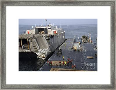 Vehicles Are Transferred Aboard Framed Print
