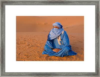 Veiled Tuareg Man Sitting Cross-legged Framed Print by Panoramic Images
