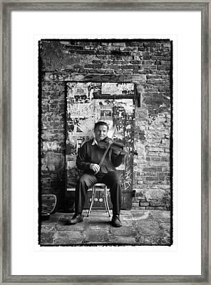 Venetian Violinist Framed Print by Tom Bell
