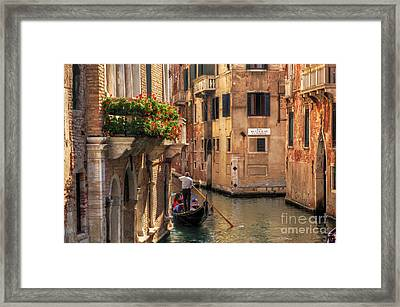 Venice Italy Gondola Floats On A Canal Among Old Venetian Architecture Framed Print