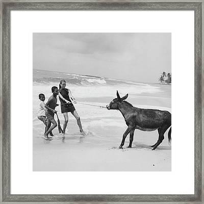 Veruschka Von Lehndorff And Two Children Pulling Framed Print