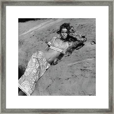Veruschka Von Lehndorff Leaning Against An Framed Print by Franco Rubartelli
