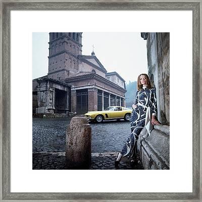 Veruschka Von Lehndorff Standing In Piazza Di San Framed Print by Franco Rubartelli
