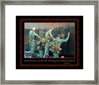 Veterans At Vietnam Wall Framed Print