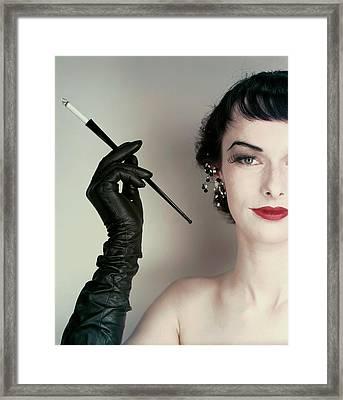 Victoria Von Hagen Holding A Cigarette Holder Framed Print by Erwin Blumenfeld