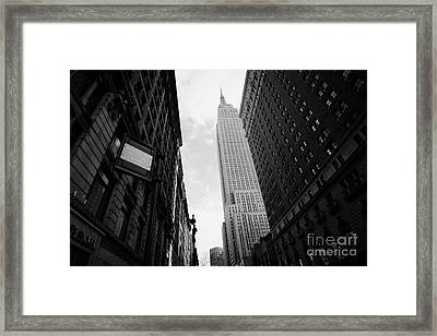 View Empire State Building From West 34th Street And Broadway Junction New York City Framed Print by Joe Fox
