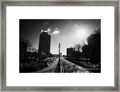 view looking along the Brooklyn bridge in blue sky with winter sunshine sun new york Framed Print