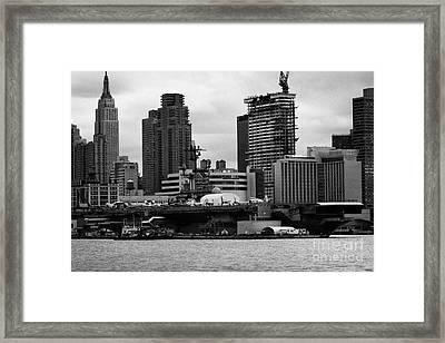 view of manhattan skyline USS Intrepid Aircraft Carrier new york city Framed Print