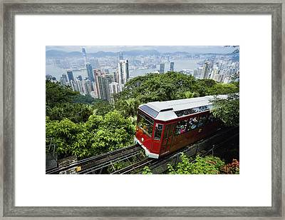 View Of Peak Tram Arriving At The Top Framed Print by Axiom Photographic