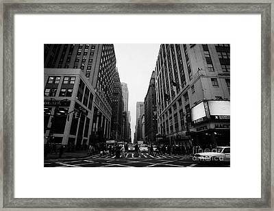 view of pedestrians crossing crosswalk on 7th Avenue and 34th Street outside macys new york city usa Framed Print