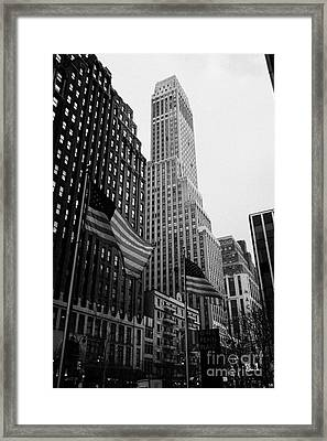 view of pennsylvania bldg nelson tower and US flags flying on 34th street from 1 penn plaza new york Framed Print by Joe Fox