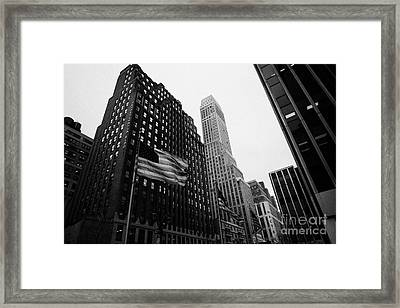 view of pennsylvania bldg nelson tower and US flags flying on 34th street from 1 penn plaza nyc Framed Print by Joe Fox