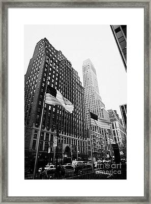 view of pennsylvania bldg nelson tower and US flags flying on 34th street new york city Framed Print by Joe Fox
