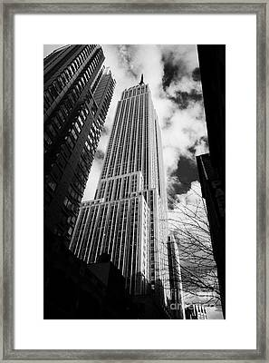 View Of The Empire State Building And Surrounding Buildings And  Cloudy Sky From West 33rd Street Ny Framed Print by Joe Fox