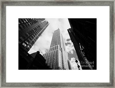 View Of The Empire State Building And Surrounding Buildings And Cloudy Sky West 33rd Street New York Framed Print by Joe Fox