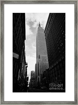 View Of The Empire State Building From West 34th Street And Broadway Junction New York City Framed Print by Joe Fox