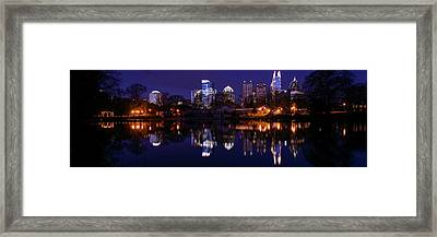 View Of The Midtown Skylines And Lake Framed Print