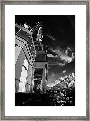 View Of The Top Of The Empire State Building Radio Mast And Tourists On Observation Deck New York Framed Print by Joe Fox