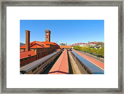 View Of Trains At Railroad Station Framed Print