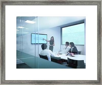 View Through Glass Wall Of Business Framed Print by Monty Rakusen