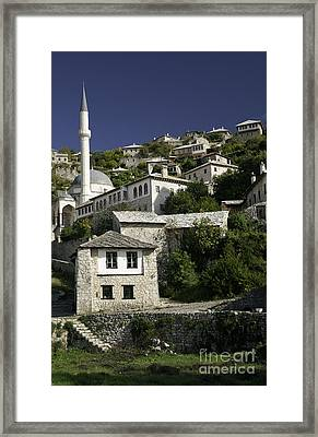 views of pocitelj in Bosnia Hercegovina with minaret bridge and river Framed Print