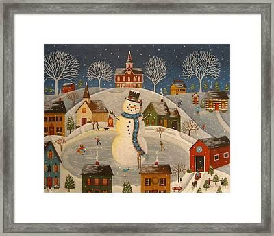 Village Snowman Framed Print by Mary Charles