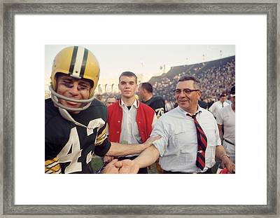 Vince Lombardi Shaking Hands Framed Print by Retro Images Archive