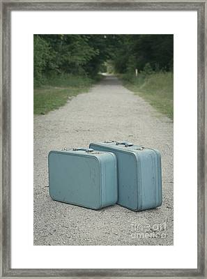 Vintage Blue Suitcases On A Gravel Road Framed Print