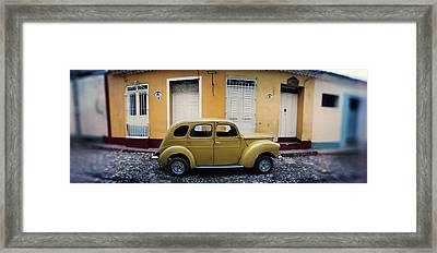 Vintage Car On The Cobblestone Street Framed Print by Panoramic Images