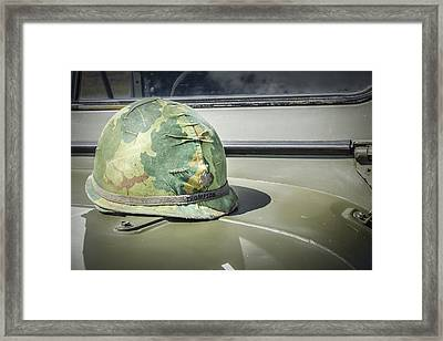 Vintage Helmet On Jeep Hood Framed Print by Bradley Clay