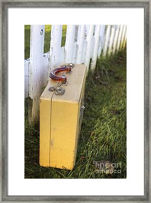 Vintage Luggage Left By A White Picket Fence Framed Print