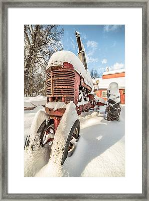 Vintage Red Farmall Tractor In The Snow Framed Print by Edward Fielding