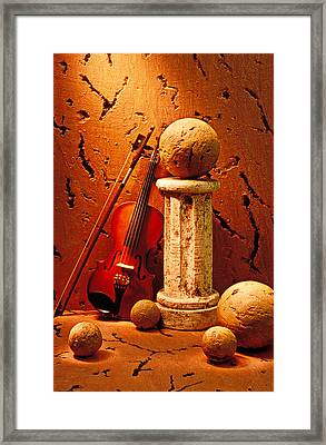 Violin And Pedestal With Stone Balls  Framed Print by Garry Gay