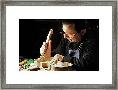 Violin-maker At Work Framed Print by Patrick Landmann