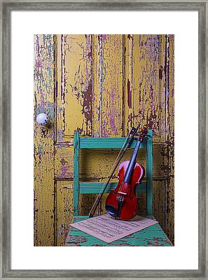 Violin On Worn Green Chair Framed Print by Garry Gay