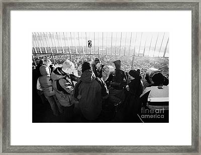 Visitors On Observation Deck Of The Empire State Building New York City Usa Framed Print by Joe Fox