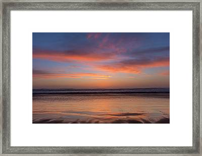 Vivid Sunset Over The Pacific Ocean Framed Print by Chuck Haney
