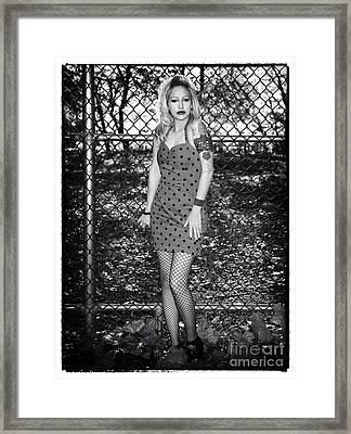 Vixen Framed Print by John Rizzuto