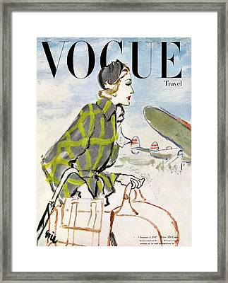 Vogue Cover Featuring A Woman Carrying Luggage Framed Print by Carl Eric Erickson