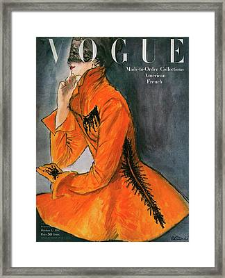 Vogue Cover Featuring A Woman In An Orange Coat Framed Print by Rene R. Bouche