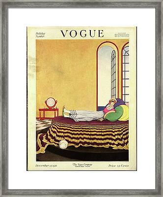 Vogue Cover Featuring A Woman Lying In Bed Framed Print by George Wolfe Plank