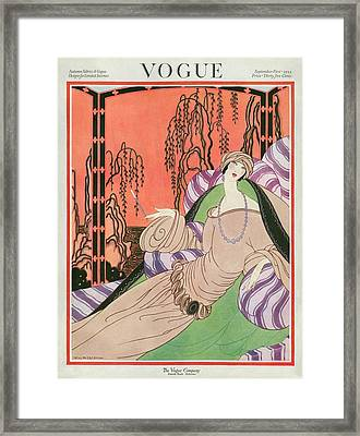 Vogue Cover Featuring A Woman On A Chair Framed Print by Helen Dryden