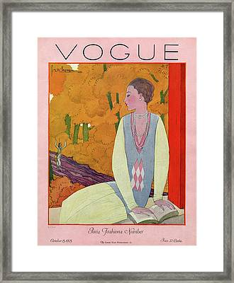 Vogue Cover Featuring A Woman Reading A Book Framed Print