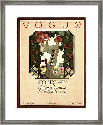 Vogue Cover Featuring A Woman Releasing A Bird Framed Print by Leslie Saalburg