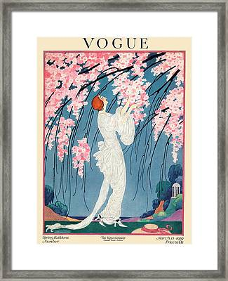 Vogue Cover Featuring A Woman Underneath A Cherry Framed Print by Helen Dryden